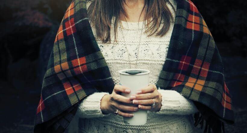 Woman Holding Travel Mug